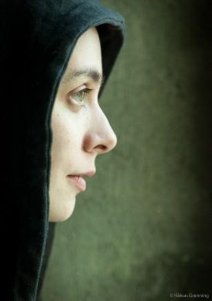 Emeli in black hood