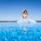 Mischkah mirrored in pool - with Mischkah