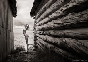 Lulu between old boatsheds - with Lulu Lockhart